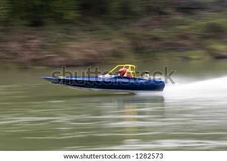 jet boat during a river race - stock photo