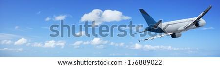 Jet cruising in a blue sky - stock photo