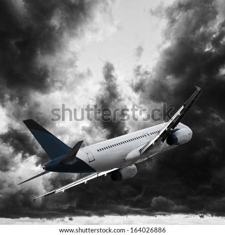 Jet cruising in a dark stormy sky - stock photo