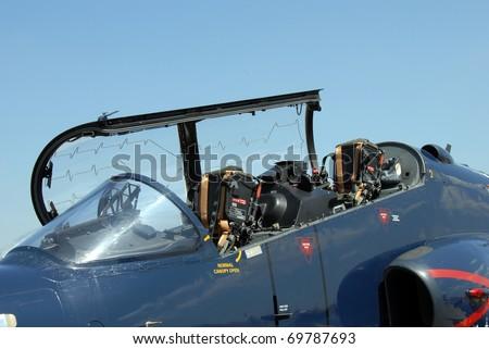jet fighter open canopy closeup - stock photo