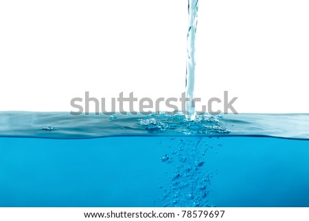 jet flowing on the water surface with gray neutral copy space - stock photo