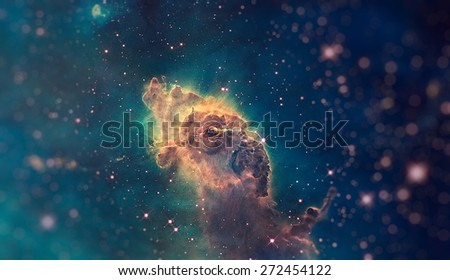 Jet in Carina Nebula. Composed of gas and dust. Scorching radiation and winds from nearby stars are sculpting the pillar and causing new stars. Small DOF. Elements of this image furnished by NASA. - stock photo