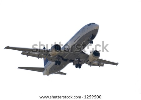 Jet landing (Boeing 737) isolated on a white background, ready to use for graphic projects - stock photo