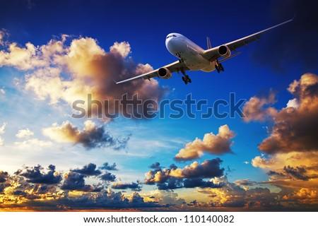 Jet maneuvering in a sunset sky - stock photo