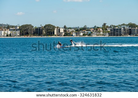 Jet Pack and Wave Runner in the background of the bay - stock photo
