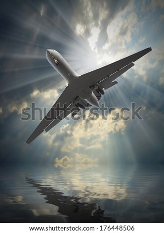 Jet passenger plane in dangerous situation over a sea. Travel and life insurance concept. - stock photo