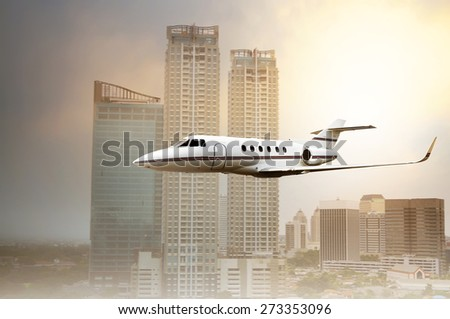 Jet plane flying low near building in the city - stock photo