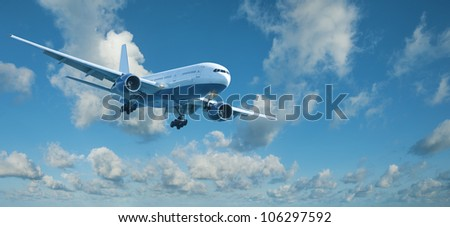 Jet plane in a blue cloudy sky is maneuvering for landing. Panoramic composition