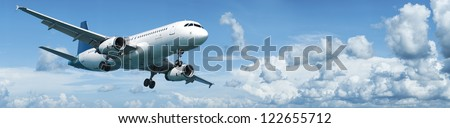 Jet plane in flight. Panoramic composition. - stock photo