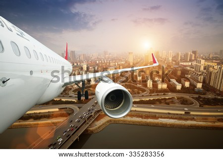 jet plane in the sunset - stock photo