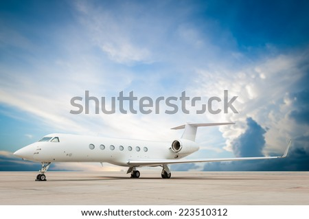 jet plane parked with nice cloud  - stock photo