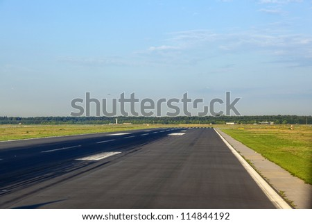 Jets landing on runway  in Frankfurt, Germany. - stock photo