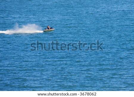 Jetski flying above the water - stock photo