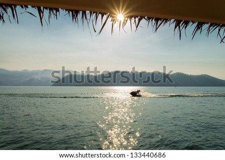 Jetski flying above the water on sunset time - stock photo