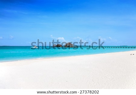 jetty and boats in the Maldives - stock photo