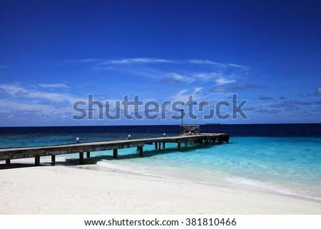 Jetty and lagoon of maldivian island  - stock photo