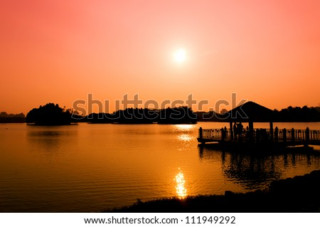 Jetty at wetland Putrajaya lake during sunset - stock photo