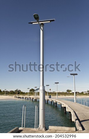 Jetty equipped with solar energy street lighting in Jurien Bay, Western Australia - stock photo