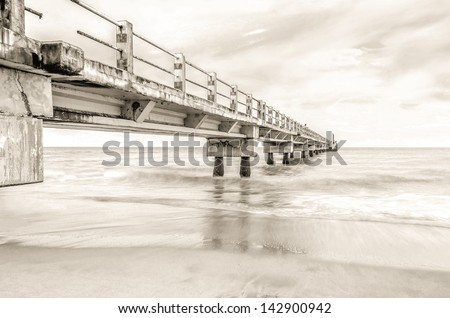 Jetty in black and white color - stock photo