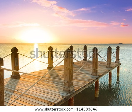 Jetty into Sunrise Heaven - stock photo