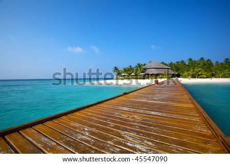 Jetty leading towards beautiful tropical Island! - stock photo