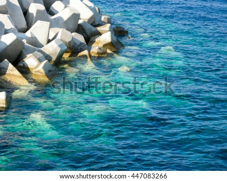 jetty mole and sea in harbor close up - stock photo