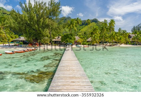 Jetty on a beach in Moorea - stock photo