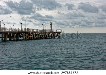 Jetty on Black sea in Sochi on cloudy day - stock photo