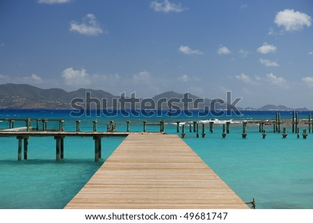 Jetty on tropical paradise Anguilla with view to St. Martin - stock photo