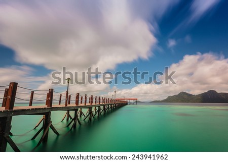 jetty provided for tourists who want to enjoy the beauty of the island - stock photo