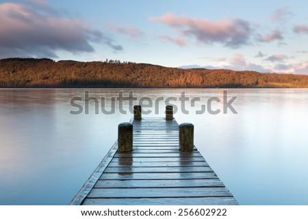 Jetty to nowhere, Lake Windermere sunrise - stock photo