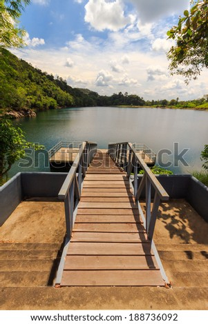 Jetty with a view of beautiful lake. - stock photo