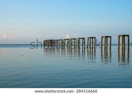 Jetty with blue sky during sunrise hour