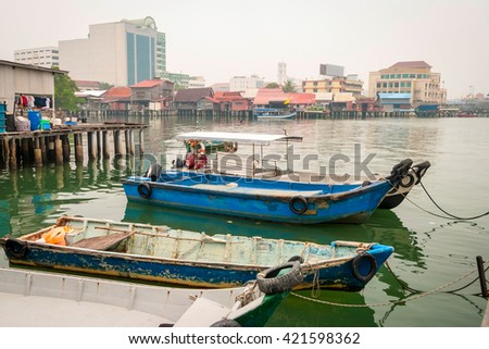 Jetty with residential houses and boats in Georgetown, Penang, Malaysia