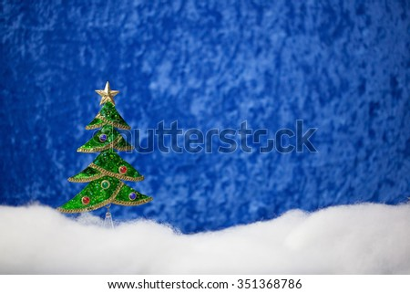 Jeweled Christmas tree and falling snow scene