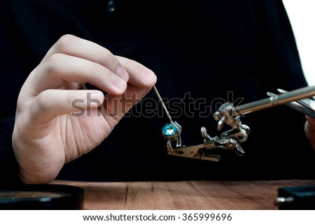 jeweler makes the product - stock photo