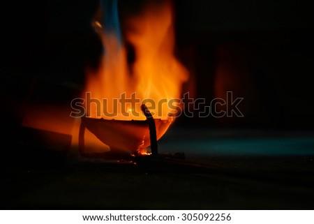 jeweler melts precious metal burner - stock photo
