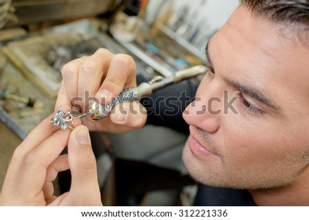 Jeweller hard at work - stock photo