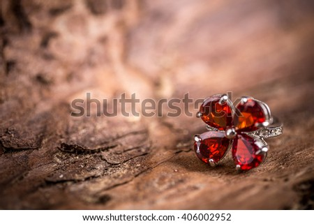 Jewellery ring with red stone, copy space