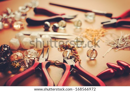 Jewelry accessories.Jewels and tools for necklace manufacturing. - stock photo