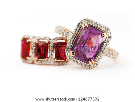Jewelry accessories pair of ring with amethyst and ruby - stock photo