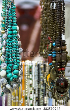 jewelry beads and natural stones of turquoise and tiger eye Indian arts - stock photo