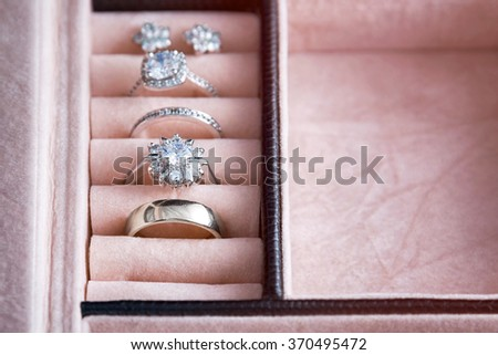 Jewelry box with white gold and silver rings. Collection of luxury jewelry - stock photo