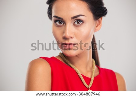 Jewelry concept. Portrait of a gorgeous female model posing isolated on a white background. Looking at camera - stock photo