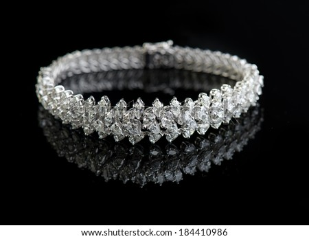 Jewelry diamond bracelet on a black background - stock photo