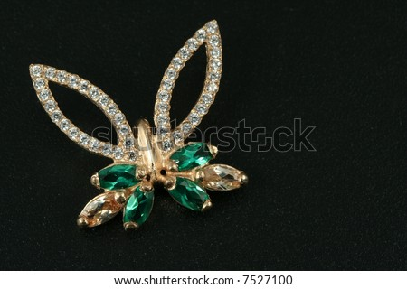 Jewelry gift. brooch with emerald & brilliants - stock photo