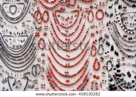 jewelry made with: tropical red coral, black onix, hematite - stock photo