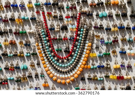 Jewelry ornaments made of various materials with wide variety of colors - stock photo