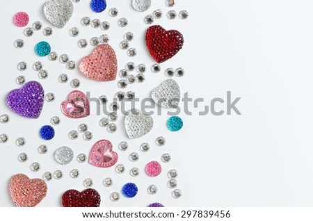 Jewelry, rhinestones, shiny stones, Swarovski stones  on a white background - stock photo