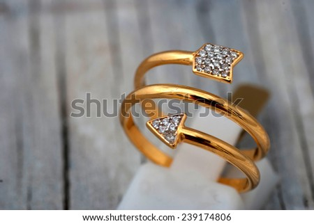 Jewelry ring on old wooden table - stock photo